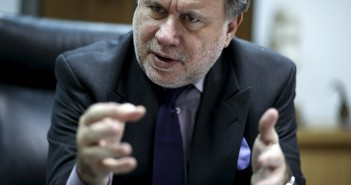Greek Labour Minister Katrougalos gestures during an interview with Reuters at his office at the ministry in Athens
